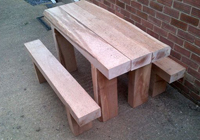 economical outdoor timber furniture Melbourne specials include solid sleeper tables